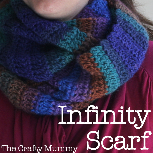 Create this easy crochet infinity scarf with variegated yarn and only 2 stitches - a great project for a beginner or a quick project for anyone.